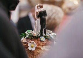 wedding cake topper of groom and bride